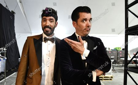 Jonathan Scott, left, and Drew Scott appear backstage during the second ceremony of the Television Academy's 2021 Creative Arts Emmy Awards at the L.A. LIVE Event Deck, in Los Angeles