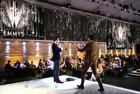Drew Scott, left, and Jonathan Scott appear on stage during the second ceremony of the Television Academy's 2021 Creative Arts Emmy Awards at the L.A. LIVE Event Deck, in Los Angeles