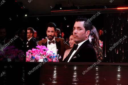 Drew Scott, from left, Linda Phan, Zooey Deschanel, and Jonathan Scott attend the second ceremony of the Television Academy's 2021 Creative Arts Emmy Awards at the L.A. LIVE Event Deck, in Los Angeles
