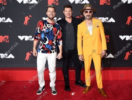 Lance Bass, from left, Nick Lachey and AJ McLean arrive at the MTV Video Music Awards at Barclays Center, in New York