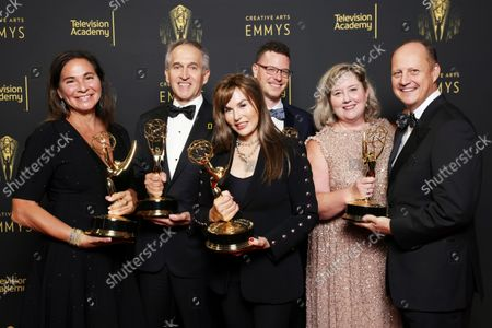 """Stock Photo of Pamela Caragol, from left, Brian Skerry, Maria Wilhelm, Shannon Malone-deBenedictis, Samuel LeGrys and Brian Armstrong, winners of the Emmy for outstanding documentary or nonfiction series for """"Secrets of the Whales"""" pose for a portrait during the second ceremony of the Television Academy's 2021 Creative Arts Emmy Awards at the L.A. LIVE Event Deck, in Los Angeles"""