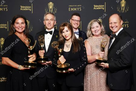 """Pamela Caragol, from left, Brian Skerry, Maria Wilhelm, Shannon Malone-deBenedictis, Samuel LeGrys and Brian Armstrong, winners of the Emmy for outstanding documentary or nonfiction series for """"Secrets of the Whales"""" pose for a portrait during the second ceremony of the Television Academy's 2021 Creative Arts Emmy Awards at the L.A. LIVE Event Deck, in Los Angeles"""