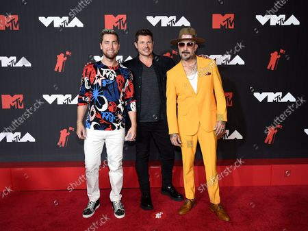 Lance Bass, from left, Nick Lachey, and AJ McLean arrive at the MTV Video Music Awards at Barclays Center, in New York