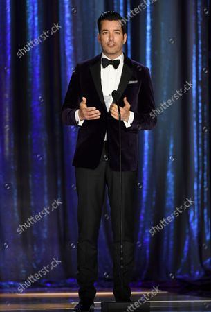 Drew Scott appear on stage during the second ceremony of the Television Academy's 2021 Creative Arts Emmy Awards at the L.A. LIVE Event Deck, in Los Angeles
