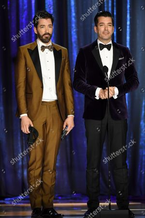 Jonathan Scott, left, and Drew Scott appear on stage during the second ceremony of the Television Academy's 2021 Creative Arts Emmy Awards at the L.A. LIVE Event Deck, in Los Angeles
