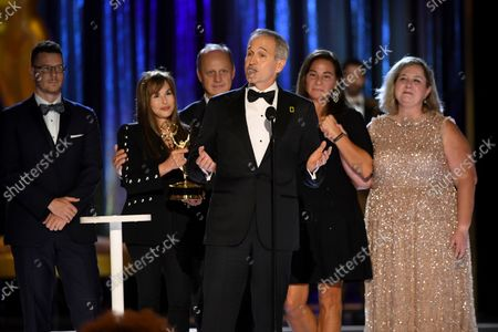 """Stock Image of Samuel LeGrys, from left, Maria Wilhelm, Brian Armstrong, Brian Skerry, Pamela Caragol, and Shannon Malone-deBenedictis accept the Emmy for outstanding documentary or nonfiction series for """"Secrets of the Whales""""during the second ceremony of the Television Academy's 2021 Creative Arts Emmy Awards at the L.A. LIVE Event Deck, in Los Angeles"""