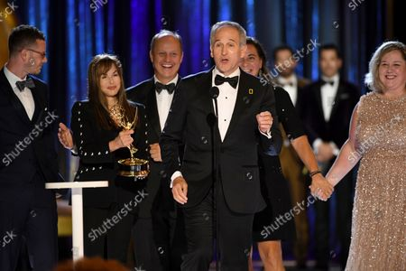 """Stock Picture of Samuel LeGrys, from left, Maria Wilhelm, Brian Armstrong, Brian Skerry, Pamela Caragol, and Shannon Malone-deBenedictis accept the Emmy for outstanding documentary or nonfiction series for """"Secrets of the Whales""""during the second ceremony of the Television Academy's 2021 Creative Arts Emmy Awards at the L.A. LIVE Event Deck, in Los Angeles"""