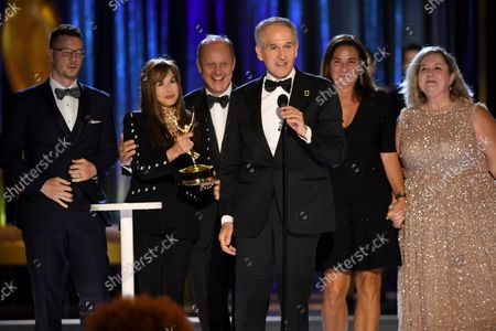 """Samuel LeGrys, from left, Maria Wilhelm, Brian Armstrong, Brian Skerry, Pamela Caragol, and Shannon Malone-deBenedictis accept the Emmy for outstanding documentary or nonfiction series for """"Secrets of the Whales""""during the second ceremony of the Television Academy's 2021 Creative Arts Emmy Awards at the L.A. LIVE Event Deck, in Los Angeles"""