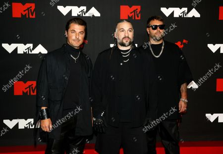 Members of the supergroup Swedish House Mafia (L-R) Axwell, Steve Angello and Sebastian Ingrosso arrive on the red carpet for the MTV Video Music Awards at the Barclays Center in Brooklyn, New York, USA, 12 September 2021.