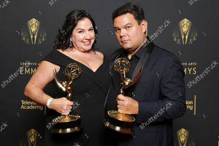"""Kristen Anderson-Lopez and Robert Lopez, winners of the Emmy for outstanding original music and lyrics for """"Agatha All Along"""" on the """"Breaking the Fourth Wall"""" episode of """"Wandavision"""" pose for a portrait during the third ceremony of the Television Academy's 2021 Creative Arts Emmy Awards at the L.A. LIVE Event Deck, in Los Angeles"""