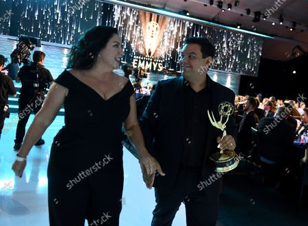"""Kristen Anderson-Lopez, left, and Robert Lopez accept the Emmy for outstanding original music and lyrics for """"Agatha All Along"""" on the """"Breaking the Fourth Wall"""" episode of """"Wandavision"""" during third ceremony of the Television Academy's 2021 Creative Arts Emmy Awards at the L.A. LIVE Event Deck, in Los Angeles"""