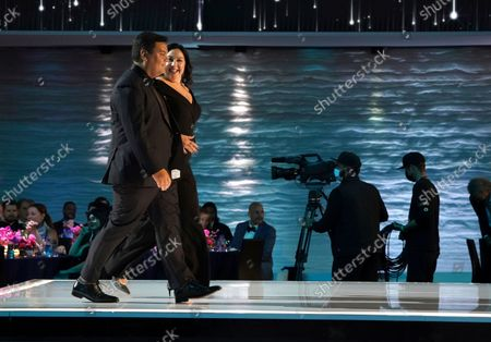 """Kristen Anderson-Lopez, left, and Robert Lopez win the Emmy for outstanding original music and lyrics for """"Agatha All Along"""" on the """"Breaking the Fourth Wall"""" episode of """"Wandavision"""" during third ceremony of the Television Academy's 2021 Creative Arts Emmy Awards at the L.A. LIVE Event Deck, in Los Angeles"""