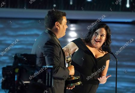 """Robert Lopez, left, and Kristen Anderson-Lopez accept the Emmy for outstanding original music and lyrics for """"Agatha All Along"""" on the """"Breaking the Fourth Wall"""" episode of """"Wandavision"""" during third ceremony of the Television Academy's 2021 Creative Arts Emmy Awards at the L.A. LIVE Event Deck, in Los Angeles"""