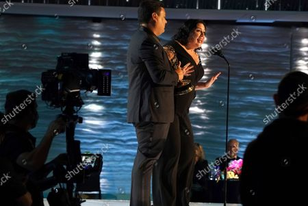 """Stock Photo of Robert Lopez, left, and Kristen Anderson-Lopez accept the Emmy for outstanding original music and lyrics for """"Agatha All Along"""" on the """"Breaking the Fourth Wall"""" episode of """"Wandavision"""" during third ceremony of the Television Academy's 2021 Creative Arts Emmy Awards at the L.A. LIVE Event Deck, in Los Angeles"""