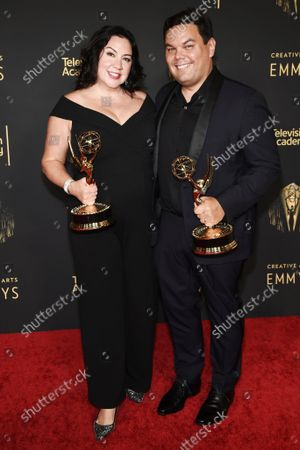 """Kristen Anderson-Lopez and Robert Lopez, winners of the Emmy for outstanding original music and lyrics for """"Agatha All Along"""" on the """"Breaking the Fourth Wall"""" episode of """"Wandavision"""" at the Media Center during the third ceremony of the Television Academy's 2021 Creative Arts Emmy Awards, in Los Angeles"""