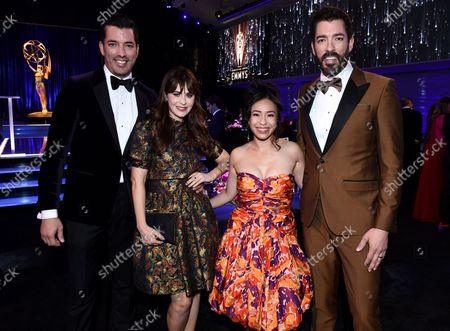 Stock Image of Drew Scott, from left, Zooey Deschanel, Linda Phan, and Jonathan Scott attend the second ceremony of the Television Academy's 2021 Creative Arts Emmy Awards at the L.A. LIVE Event Deck, in Los Angeles