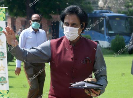 Ramiz Raja, former Pakistan cricketer and candidate for the chairman of Pakistan Cricket Board, waves to media as he arrives to attend PCB's governing board meeting, in Lahore, Pakistan, . Raja is set to become the new chairman of the country's cricket board. Prime Minister Imran Khan, in his role as patron of the Pakistan Cricket Board, nominated Raja to the governing board after Ehsan Mani declined to accept a short-term extension when his three-year term expired last week