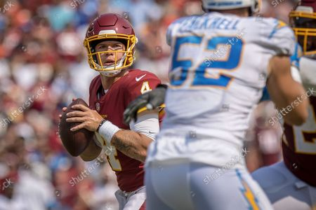 Stock Image of Washington Football Team quarterback Taylor Heinicke (4) comes into the game in relief for starting quarterback Ryan Fitzpatrick (14) during the NFL regular season game between the Los Angeles Chargers and the Washington Football Team at FedEx Field in Landover, Maryland Photographer: Cory Royster