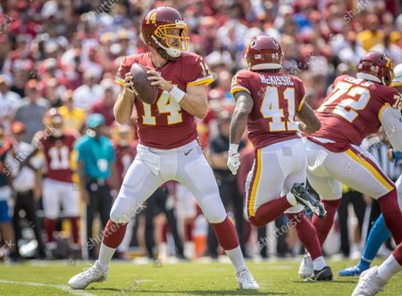 Stock Picture of New offseason acquisition Washington Football Team quarterback Ryan Fitzpatrick (14) drops back to pass during the NFL regular season game between the Los Angeles Chargers and the Washington Football Team at FedEx Field in Landover, Maryland Photographer: Cory Royster