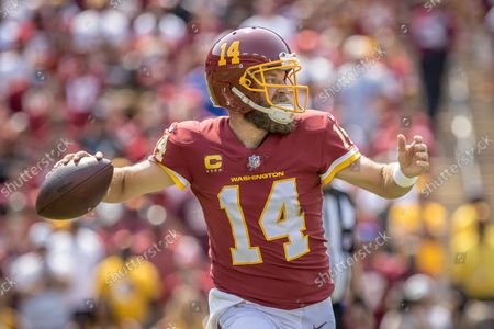 Washington Football Team quarterback Ryan Fitzpatrick (14) drops back to pass during the NFL regular season game between the Los Angeles Chargers and the Washington Football Team at FedEx Field in Landover, Maryland Photographer: Cory Royster