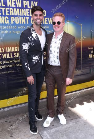 Justin Mikita and Jesse Tyler Ferguson arrive at the Broadway opening for Pass Over, held at the August Wilson Theatre, on September 12, 2021, in New York City.