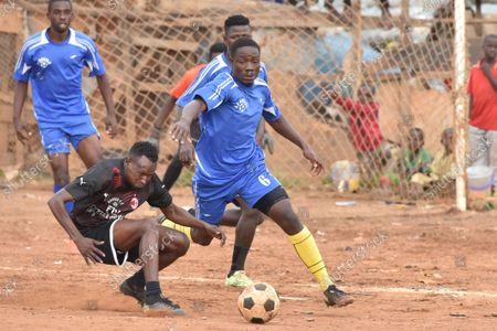 """Stock Photo of (210913) - YAOUNDE, Sept. 13, 2021 (Xinhua) - Players compete during a holiday championship at the Paul Biya stadium of the Briqueterie district, in Yaounde, Cameroon, Sept. 4, 2021. (Xinhua/Kepseu) TO GO WITH """"Feature: Holiday football tournament fuels dreams for youngsters as Cameroon gets set for AFCON"""" - Kepseu -"""