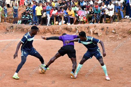"""(210913) - YAOUNDE, Sept. 13, 2021 (Xinhua) - Players compete during a holiday championship at the Paul Biya stadium of the Briqueterie district, in Yaounde, Cameroon, Sept. 4, 2021. (Xinhua/Kepseu) TO GO WITH """"Feature: Holiday football tournament fuels dreams for youngsters as Cameroon gets set for AFCON"""" - Kepseu -"""