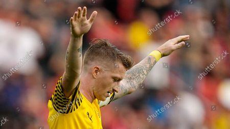 Dortmund's Marco Reus celebrates after winning the German Bundesliga soccer match between Bayer Leverkusen and Borussia Dortmund in Leverkusen, Germany