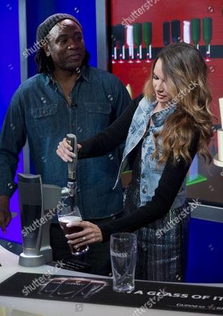 Reginald D Hunter watches Nadine Coyle pour a pint of Guinness