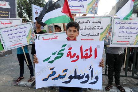 Editorial picture of Palestinians hold placadrs during a rally on the occasion of the 28th anniversary of the Oslo accords between Palestinians and Israel, in Gaza city, Gaza city, Gaza Strip, Palestinian Territory - 13 Sep 2021