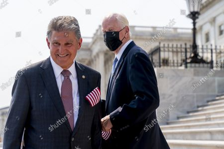 Rep. Mike Thompson, D-Calif., right, speaks with Sen. Joe Manchin, D-W.Va., left, following a Congressional Remembrance Ceremony marking the 20th anniversary of the Sept. 11, 2001, terrorist attacks, on Capitol Hill in Washington