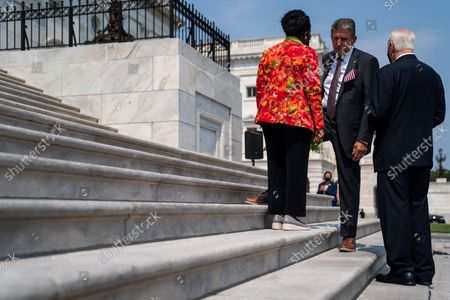 Rep. Sheila Jackson Lee (D-TX), left, and Rep. Mike Thompson (D-CA), right, speak with Sen. Joe Manchin (D-WV), center, following a remembrance ceremony marking the 20th anniversary of the 9/11 terror attacks, held on the steps of the U.S. Capitol building on Monday, Sept. 13, 2021 in Washington, DC. After a month long recess, the Senate returns to session this week. (Kent Nishimura / Los Angeles Times)