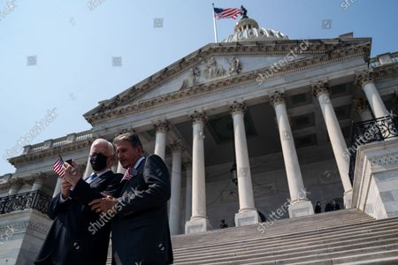 Stock Image of Rep. Mike Thompson (D-CA), left, speaks with Sen. Joe Manchin (D-WV), right, following a remembrance ceremony marking the 20th anniversary of the 9/11 terror attacks, held on the steps of the U.S. Capitol building on Monday, Sept. 13, 2021 in Washington, DC. After a month long recess, the Senate returns to session this week. (Kent Nishimura / Los Angeles Times)