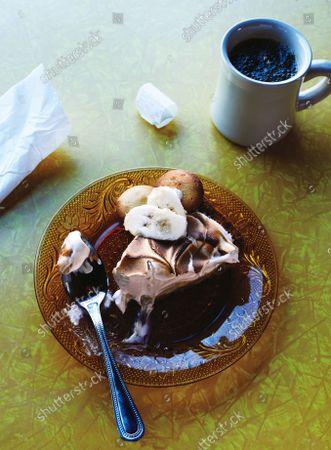 Banana pudding pie and a mug of coffee.