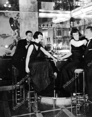 Edgar Scott, Mrs. B.F. Pepper, Mrs. Scott, and Mr. Persifor Frazer seated at bar; Photograph taken at an unidentified, Art Deco nightclub in Philadelphia.