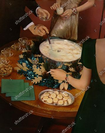 Stock Image of Interior, Christmas Table, with silver bowl of eggnog, dish of small sandwiches; man's arm ladels out egg nog, woman holds glass of egg nog, and woman's arm, at right, holds cigarette; green napkins and walnuts also on table.