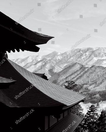 Yamadera's Risshaku-ji temple overlooking snowy mountains in Yamagata, Japan.