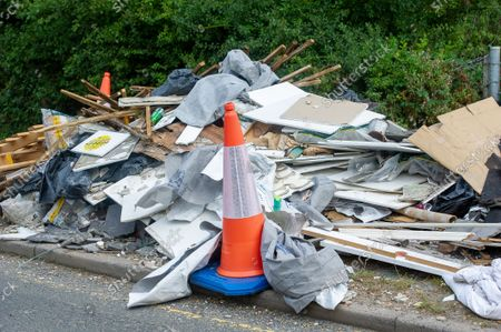 Stock Picture of Building material fly tipped on a country lane next to an emergency access point. There has been a huge increase in illegal fly tipping in Buckinghamshire. Buckinghamshire Council now make charges for the disposal of some household items ranging from £3.10 to £24.80 per item which may be the reason why illegal fly tipping has increased so much in Buckinghamshire