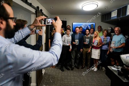 Stock Image of Supporters of the effort to recall California Governor Gavin Newsom pose for a picture with state Sen. Brian Jones, center in blue jacket, at the San Diego Republican Party Headquarters, in San Diego. Voting concludes Tuesday in California's recall election