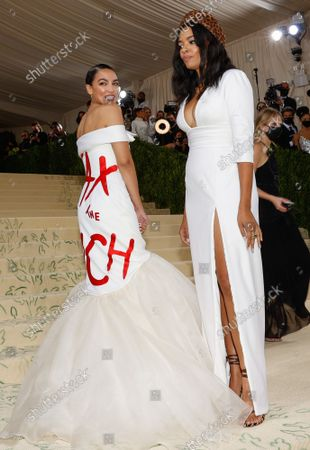 US Senator Alexandria Ocasio-Cortez and Aurora James arrive for The Met Gala at The Metropolitan Museum of Art celebrating the opening of In America: A Lexicon of Fashion in New York City on Monday, September 13, 2021.