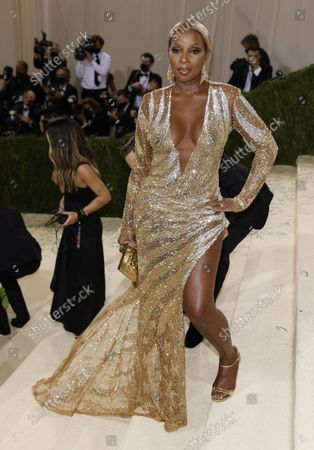 Mary J Blige poses on the red carpet for the 2021 Met Gala, the annual benefit for the Metropolitan Museum of Art's Costume Institute, in New York, New York, USA, 13 September 2021. The event coincides with the Met Costume Institute's first two-part exhibition, 'In America: A Lexicon of Fashion' which opens 18 September 2021, to be followed by 'In America: An Anthology of Fashion' which opens 05 May 2022 and both conclude 05 September 2022.