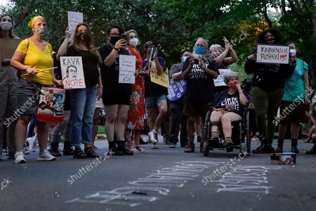 Protesters gather outside the home of Supreme Court Justice Brett Kavanaugh, in Chevy Chase, Md., after a high-profile decision earlier this month in which the court by 5-4 vote declined to step in to stop a Texas law banning most abortions from going into effect, prompting outrage from abortion rights groups and President Joe Biden