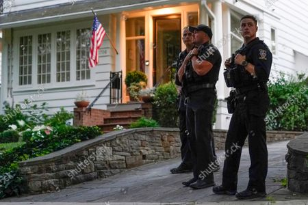 Members of the Montgomery County Police Department stand outside the home of Supreme Court Justice Brett Kavanaugh, in Chevy Chase, Md., after a high-profile decision earlier this month in which the court by 5-4 vote declined to step in to stop a Texas law banning most abortions from going into effect, prompting outrage from abortion rights groups and President Joe Biden