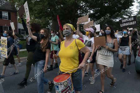 Abortion rights demonstrators march outside of Supreme Court Justice Brett Kavanaugh's home in Chevy Chase, Md., after a high-profile decision earlier this month in which the court by 5-4 vote declined to step in to stop a Texas law banning most abortions from going into effect, prompting outrage from abortion rights groups and President Joe Biden