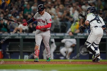 Stock Picture of Boston Red Sox's Alex Verdugo, left, reacts next to Seattle Mariners catcher Tom Murphy after striking out swinging to end the top of the sixth inning of a baseball game, in Seattle