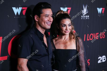 Actor/television host Mario Lopez and wife/actress Courtney Laine Mazza arrive at the Los Angeles Premiere Of Vision Films' 'I Love Us' held at the Harmony Gold Theater on September 13, 2021 in Hollywood, Los Angeles, California, United States.