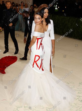 U.S. Congress Representative Alexandria Ocasio-Cortez  and Aurora James arrive for The Met Gala at The Metropolitan Museum of Art celebrating the opening of In America: A Lexicon of Fashion in New York City on Monday, September 13, 2021.
