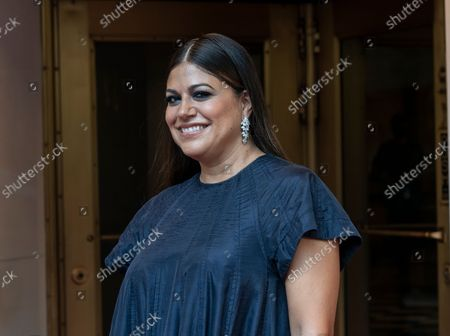 Stock Picture of Mindy Kaling wearing dress by Tory Burch departs The Pierre Hotel for Met Gala Celebrating In America: A Lexicon Of Fashion.