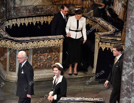 Stock Picture of Crown Princess Victoria, Prince Daniel, King Carl Gustaf and Queen Silvia leaving the church service in Stockholm Cathedral held before the Opening of the Parliamentary Session in Stockholm, Sweden, September 14, 2021.