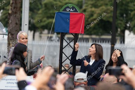 Stock Picture of Laeticia Hallyday with daughters Jade Hallyday and Joy Hallyday and Paris Mayor Anne Hidalgo